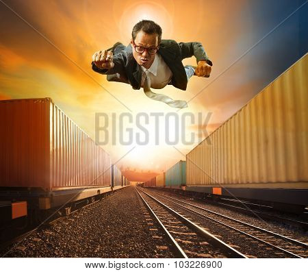 Business Man Flying And Industry Container Trainst Running On Railways Track Against Beautiful Sun S