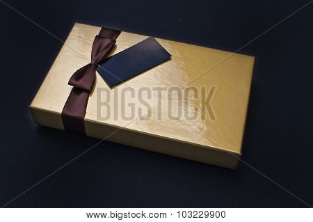 Golden Chocolate Box Closed With Black Label