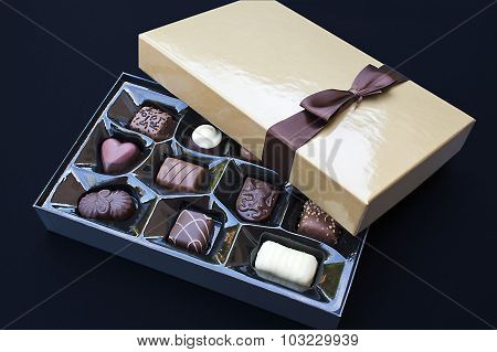 Open Golden Chocolate Box