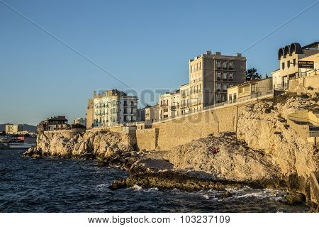 People Enjoy Sunset At The Corniche Kennedy In Marseille