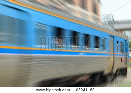 Blurred Zoom Of People On Train