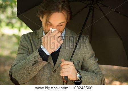 Businessman with opened umbrella