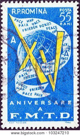 ROMANIA - CIRCA 1960: A stamp printed in Romania shows XV, Globe and Peace Banner