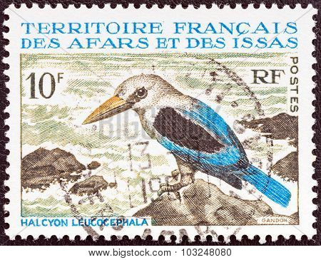 FRENCH TERRITORY OF AFARS AND ISSAS - CIRCA 1967: Stamp shows a Grey-headed Kingfisher
