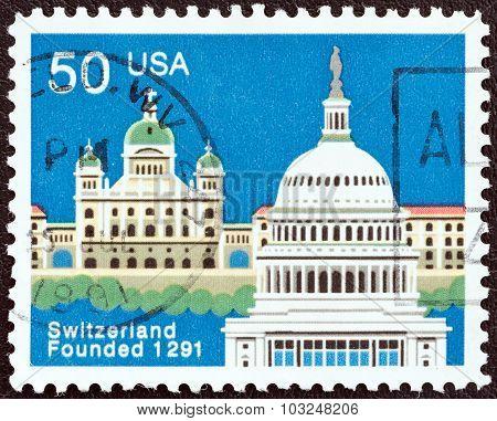 USA - CIRCA 1991: A stamp printed in USA shows Federal Palace, Bern and Capitol, Washington