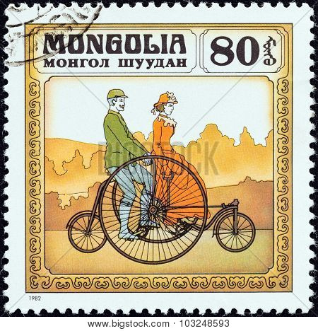 MONGOLIA - CIRCA 1982: A stamp printed in Mongolia shows Coventry Rotary Tandem, 1870s