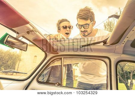 Couple Of Lovers Looking to Map at Honeymoon Trip Vacation - Vintage Lifestyle Traveling