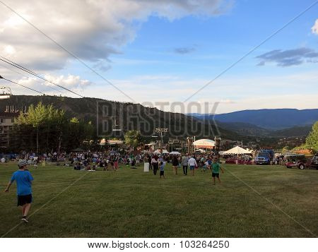 People And Kids Watch Concert On Field With Ski Lift During Wanderlust Festival