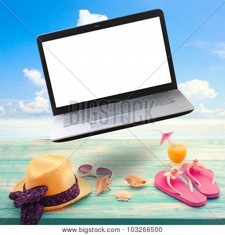 Summer background with necessities and laptop white screen.