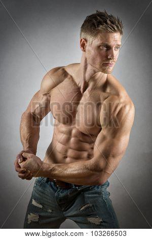Athlete In Denim Trousers