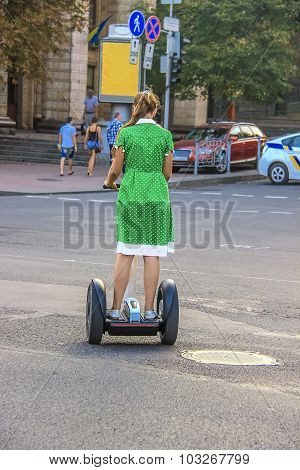 Girl riding a personal mobility device