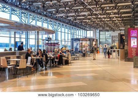 MILAN, ITALY - SEPTEMBER 22, 2015: People in departure area of Milan Malpensa Airport Terminal 2 used by EasyJet -  largest airport in Northern Italy, currently the 28th busiest airport in Europe.
