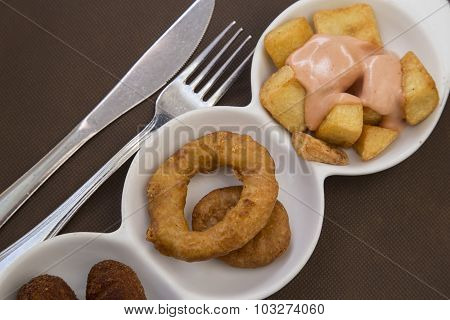 tapas fried squid rings and potates braves