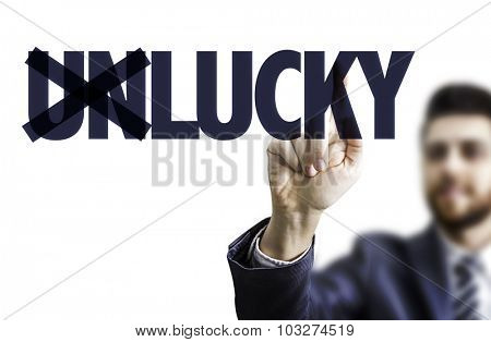Business man pointing the text: UnLucky