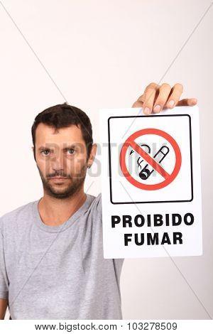 man with non smoke sign