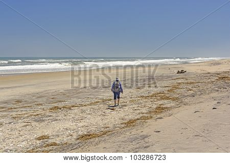 Heading Out On A Remote Beach