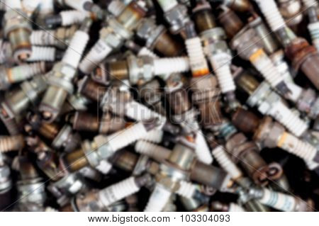 The Blurred Old Spark Plug Are In Part Of A Car And They Are Waiting Desertion