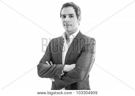Black And White Image Of Successful Young Businessman Standing With His Arms Crossed Looking Confide