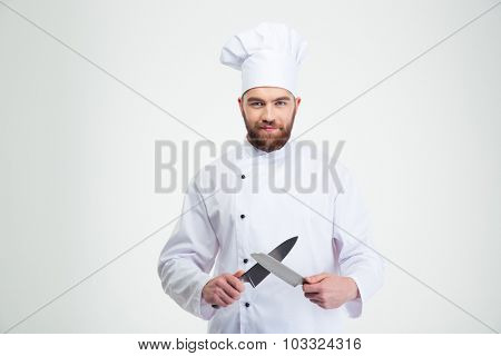 Portrait of a happy male chef cook sharpening knife isolated on a white background