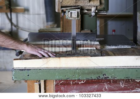 Craftsmen Cut A Piece Of Wood At A Woodworking Factory In Greece.