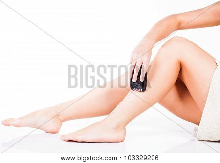 Smooth woman shaving legs with electric shaver depilator poster