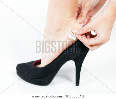 Closeup Of Woman's Heel With Blister Plaster On