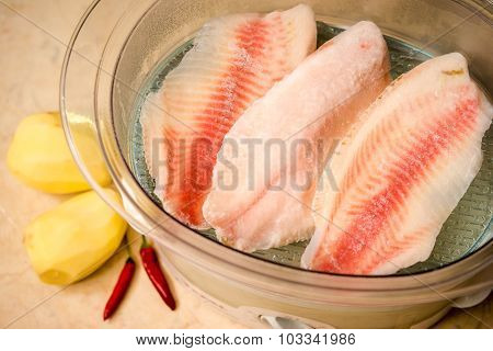 cooking healthy fish on vapor close up poster