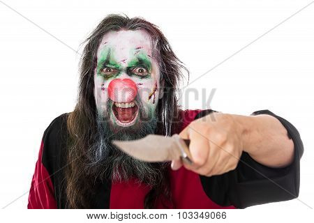 Evil Clown Threatening The Beholder With A Knife, Isolated On White