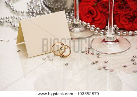 Wedding Rings With Writing Card And Champagne
