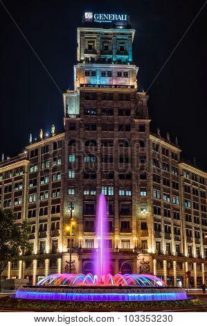Passeig de Gracia fountain at night