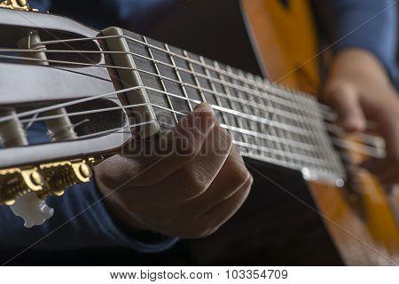Child Playing Guitar Close up
