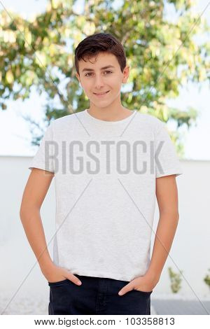 Casual Thirteen year old teenage boy smiling outside