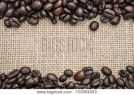 Fresh roasted coffee beans on hessian