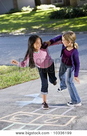 Girls Playing Hopscotch
