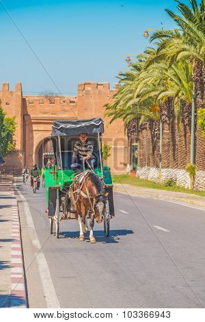 TAROUDANT, MOROCCO, APRIL 9, 2015: Horse drawn carriage near the gate in ancient walls