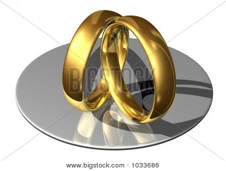 Golden Wedding Rings Leaning Against Each Other