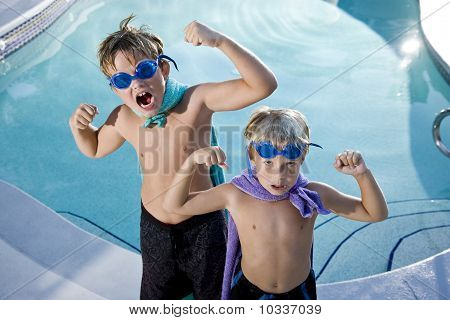 Superheroes Show Their Muscles By Swimming Pool