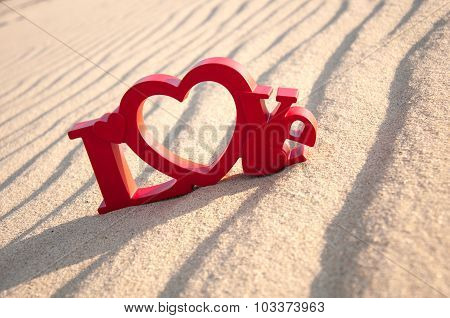 The word love and the sand in the background
