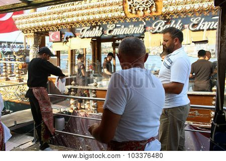 Fisher men selling fish grilled