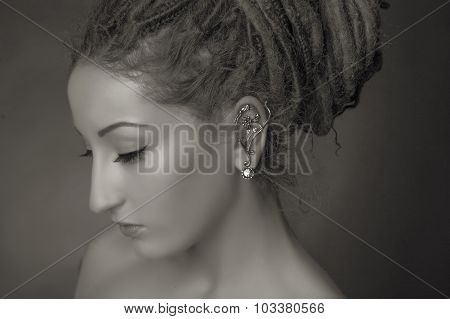 Stylized Fashion Shoot. Woman With A Dreadlocks Bun Hairstyle