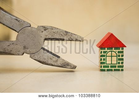 Pliers and a little house