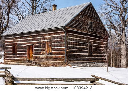 Log House on a Sunny Winter Day