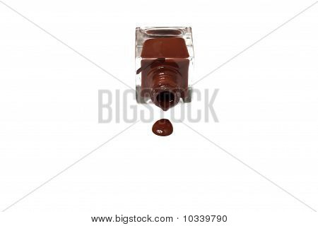 Brown Nail Polish Bottle With Splatters Isolated On White Background