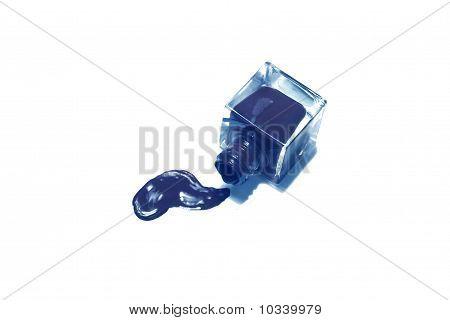Blue Nail Polish Bottle With Splatters Isolated On White Background