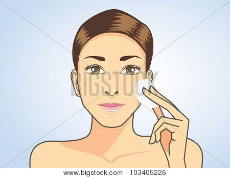 Cleaning face skin with facial cotton