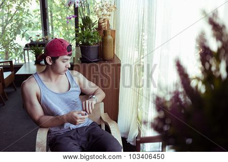 Man Sitting Waiting A Person In Coffee Cafe, Image Used Vintage Filter