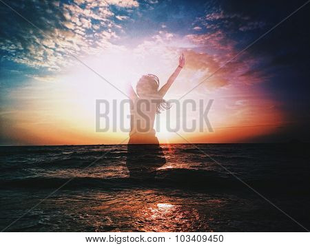 Silhouette of a Happy Girl Jumping on the Beach