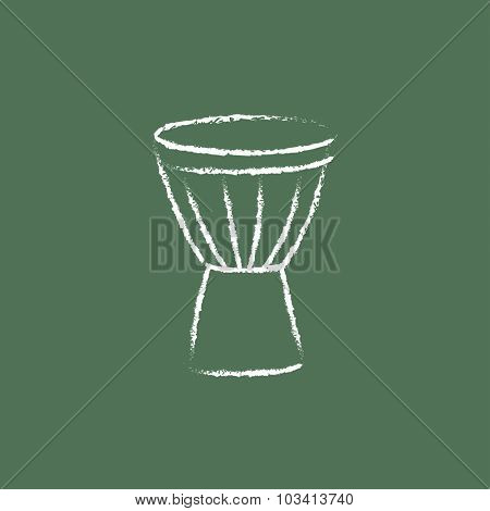 Timpani hand drawn in chalk on a blackboard vector white icon isolated on a green background.