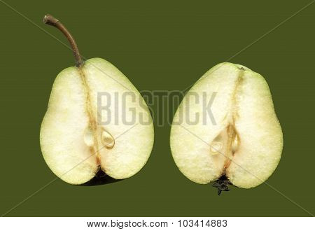 Two halves of one fruit pears isolated on a green background.