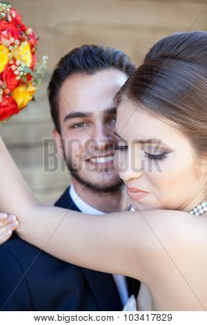Bride Smiling While Embracing The Groom
